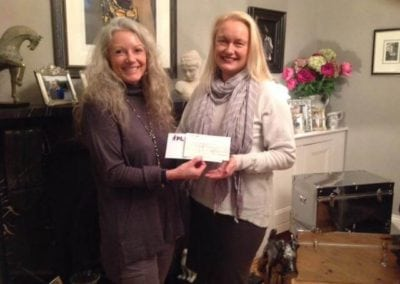 Fundraise - Shelley presents a cheque